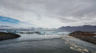 Icebergs floating out of the lagoon towards the Atlantic ocean